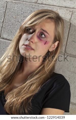 Image of crying abuse woman looking up - stock photo