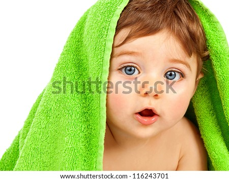 Image of cute baby boy covered with green towel isolated on white background, closeup portrait of cheerful kid with blue eyes, health care, pretty infant after bath, happy childhood, child's hygiene - stock photo