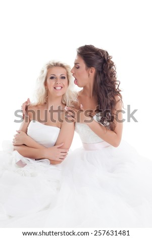Image of cute brides fooling around at camera - stock photo