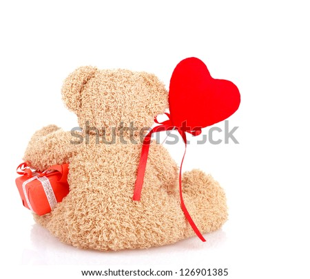 Image of cute furry teddy bear sitting back side and holding little gift box and red heart-shaped balloon, soft toy as present for Valentines day holiday, 14 of february, romantic date, love concept - stock photo
