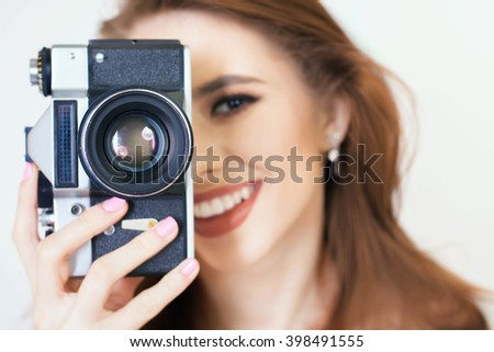 Image of cute girl make a photo selfie at vintage camera. Take a photograph. Funny, party. Beauty. Happy girl smiling. Makeup and hairstyle - stock photo