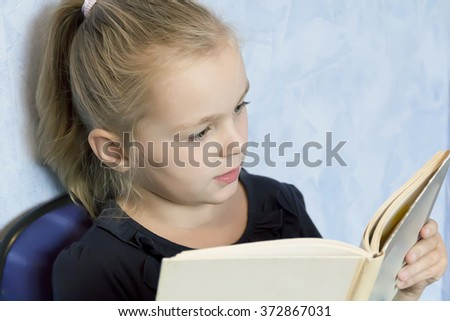 Image of cute girl reading a book