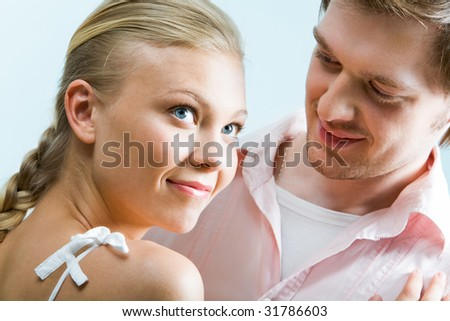 Image of cute girl staring upwards while handsome man looking at her - stock photo