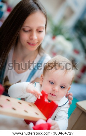 Image of cute little baby with mom. Mother and daughter outdoor. Girl and woman play together. - stock photo