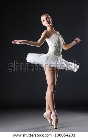 Image of cute young ballerina dancing in studio - stock photo
