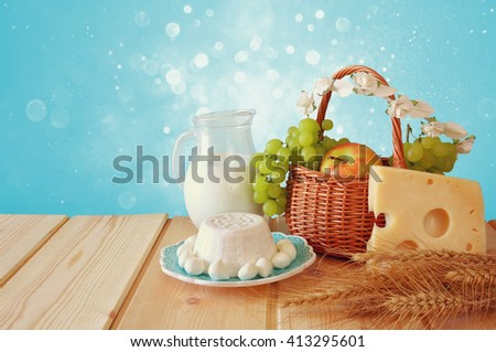 image of dairy products and fruits on wooden table. Symbols of jewish holiday - Shavuot  - stock photo