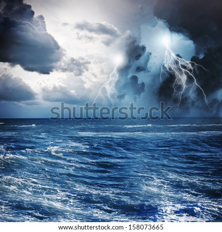 Image of dark night with lightning above stormy sea - stock photo