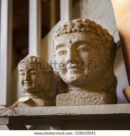 Image of decorative concrete Buddha heads.  - stock photo