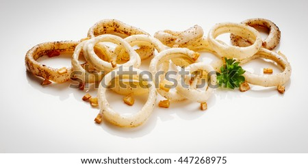 Image of delicious calamari saut�©ed in garlic to apply to label design