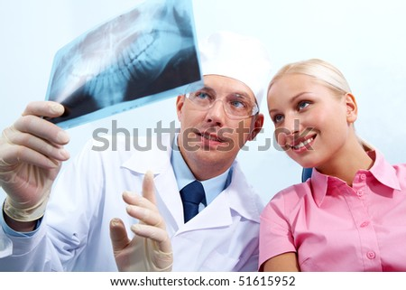 Image of dentist giving medical consulting to woman