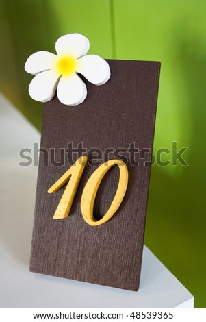 Image of design number sign for number of table in restaurant. - stock photo