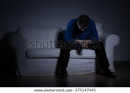 Image of despair man thinking about his problems - stock photo