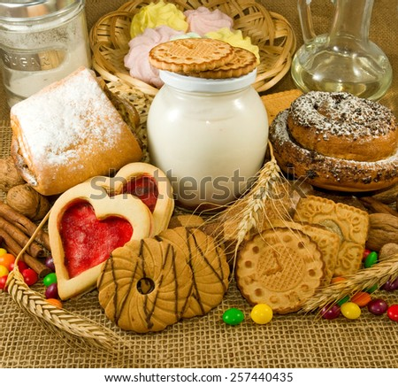 image of different cookies with yogurt and bank closeup - stock photo