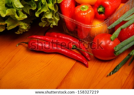 Image of different kindes of fresh washed peppers