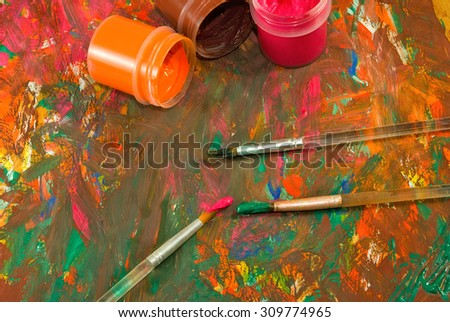 image of  different paints and three brushes - stock photo