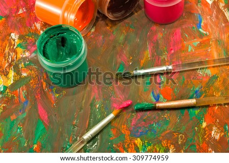 image of  different paints and three brushes closeup - stock photo