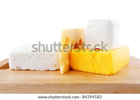 image of different types of cheeses on woode