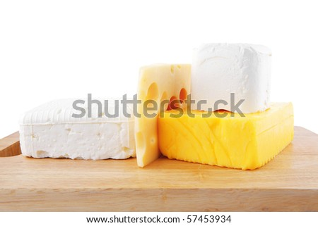image of different types of cheeses on wooden