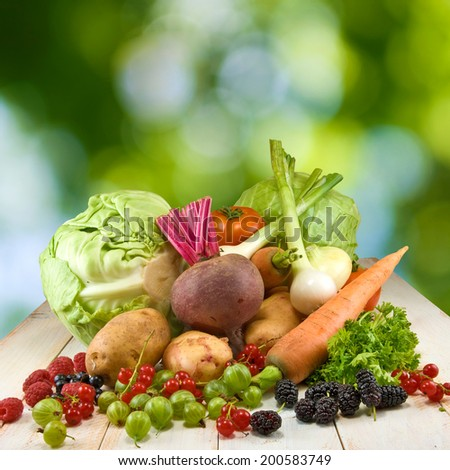 image of different vegetables on a green background