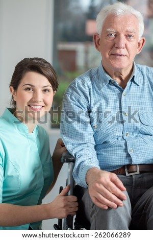 Image of disabled man and social welfare worker - stock photo