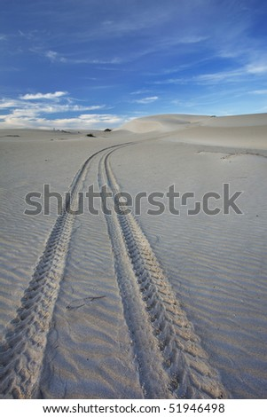 Image of Dunes on the South African coast line in the Western Cape with tracks - stock photo