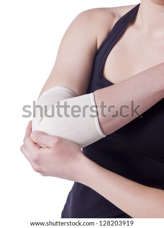 Image of elbow band in female elbow against white background - stock photo