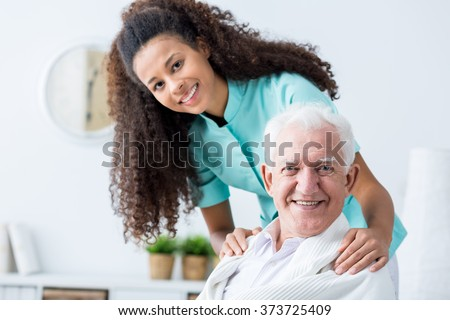 Image of elderly man having private home care - stock photo