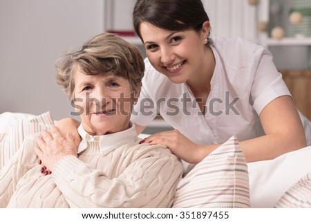 Image of elderly woman having professional medical care