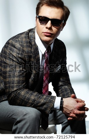 Image of elegant man posing in front of camera - stock photo