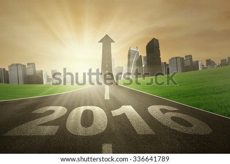 Image of empty highway with numbers 2016 and upward arrow on the end of the road - stock photo