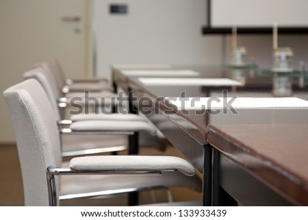 Image of empty modern boardroom meeting - stock photo
