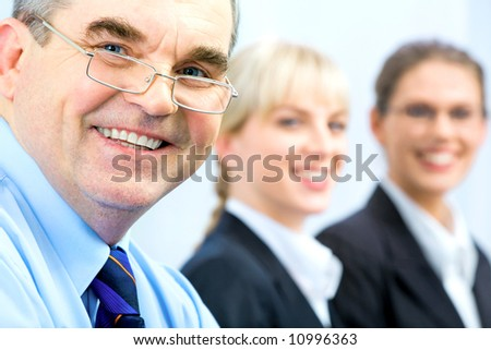 Image of faces of business people with boss in front - stock photo