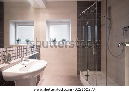 Image of fancy black and white bathroom with big shower