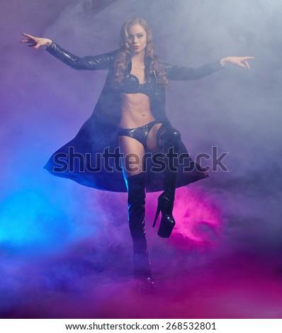 Image of fantastic female dancer in latex lingerie - stock photo