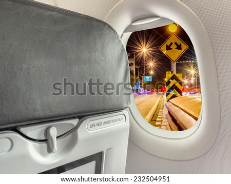 image of  fasten seat belt while seated sign on airplane. - stock photo
