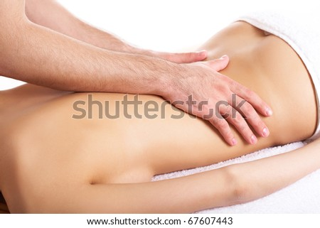 Image of female back being massaged by male hands