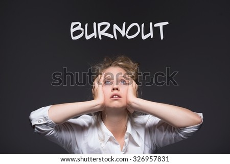 Image of female burnout workplace harassment victim - stock photo