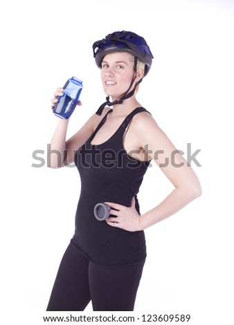 Image of female cyclist holding blue drink bottle against white background - stock photo