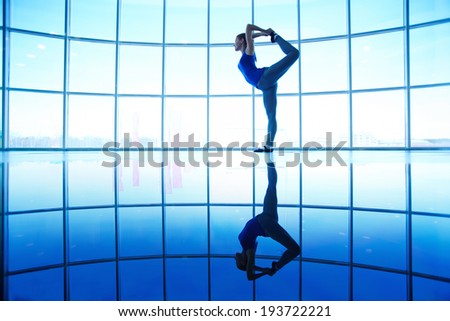 Image of female doing physical exercise for stretching - stock photo