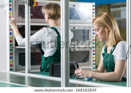 Image of female engineers working in factory - stock photo