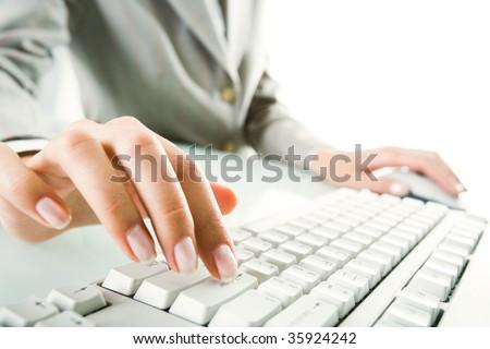 Image of female fingers over enter key - stock photo