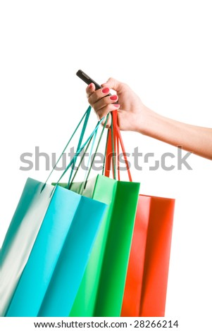 Image of female hand holding colorful shopping bags and phone - stock photo