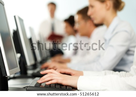 Image of female hands typing on keyboard in a working environment - stock photo