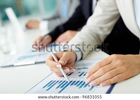 Image of female hands with pen and business document during lecture - stock photo