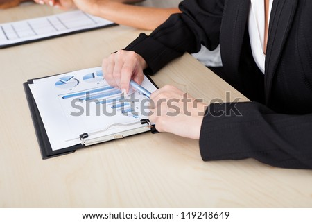 Image of female hands working with bar graphs - stock photo