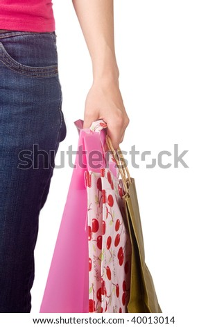 Image of female holding shoppingbags in her hand isolated on white - stock photo