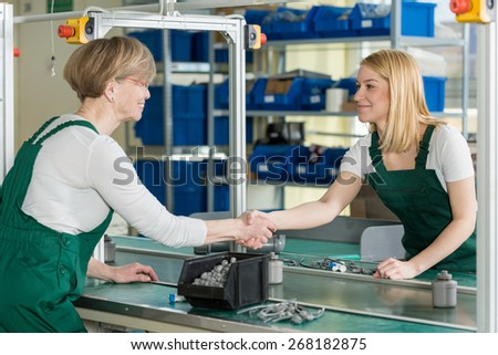 Image of female line workers shaking hands