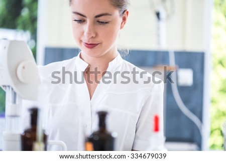 Image of female microbiology student during internship in professional lab - stock photo