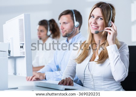 Image of female phone operator with headset during work - stock photo