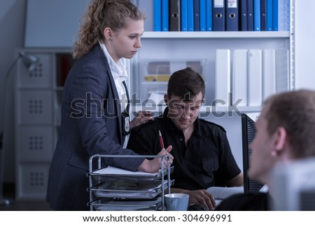 Image of female police officer during work in crime department - stock photo